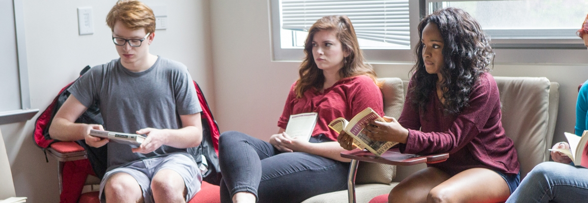 Students in a group discussing a book