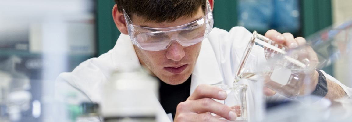 student wearing goggles in a chemistry laboratory