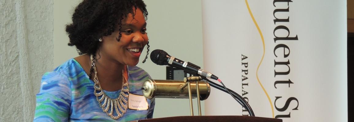 SSS program graduate speaks at a podium
