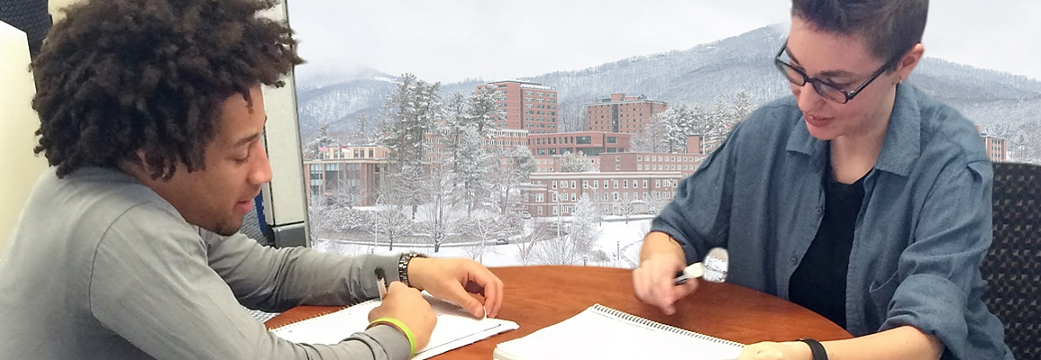 Student and tutor at a table